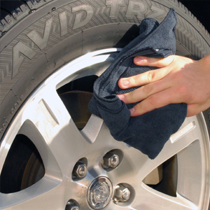 Buff off Detailer's Pro Series DP Wheel Glaze with a microfiber towel.