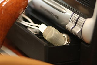 The Flashlighter plugs into the car's power port to charge any electronic device using a USB port.