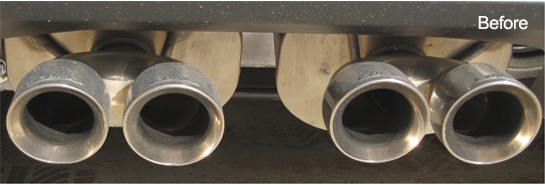 Image shows chrome exhaust tips before using Menzerna Polishig Cream.