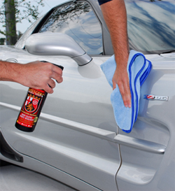 Wolfgang Deep Gloss Spritz Sealant being used on a silver Corvette.