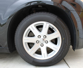 You can see the difference in color of the side treated with Wolfgang Black Diamond Tire Gel and the untreated side.