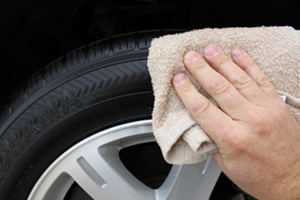 Pat off excess tire gel with a towel that you only use for tires.