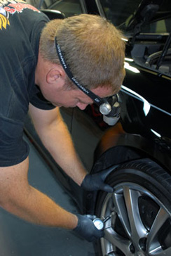 Use the Brinkmann Head Lamp to change flat tires at night.
