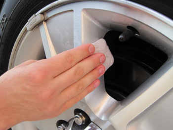 Use detailing clay to remove embedded particles from alloy wheels.