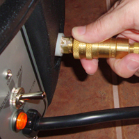 Fill the solution tank with warm water and connect the solution hose.