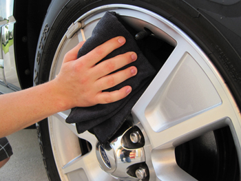 Dry alloy wheels with a microfiber towel.