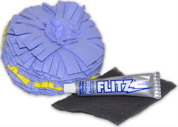 The Flitz Headlight Kit includes a Buff Ball, Flitz polish, and a scrub pad.