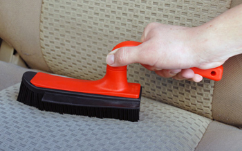 German Upholstery Brush & Squeegee removes pet hair and dirt.