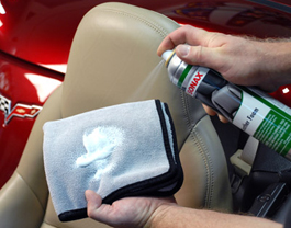 Spray Sonax Leather Foam onto a clean microfiber towel.