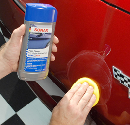Spread Sonax Paint Cleaner over one section at a time.