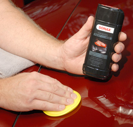 Spread Sonax Premium Class Paint Cleaner onto one section at a time.