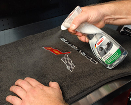 Spray the carpet with Sonax Upholstery & Carpet Cleaner onto the desired spot.