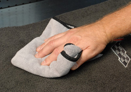 Use a microfiber towel to agitate the carpet and soak up the clear and dirt.