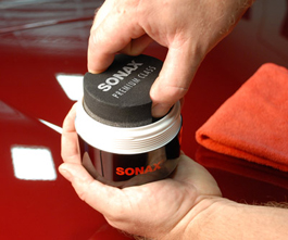 Apply Sonax Premium Class Carnauba Wax with the included ergonomic applicator.
