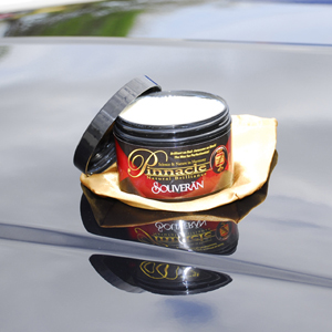 Pinnacle Souveran Wax sets the standard for reflection on black and red cars.