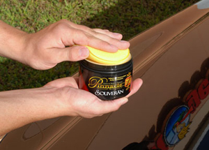 Apply Souveran Wax with a foam applicator pad.