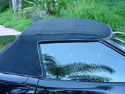 303 High Tech Fabric Guard protects fabric convertible tops by restoring lost water repellency.