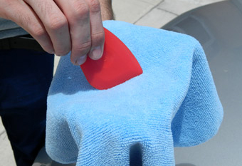 How to remove wax from in between body panels