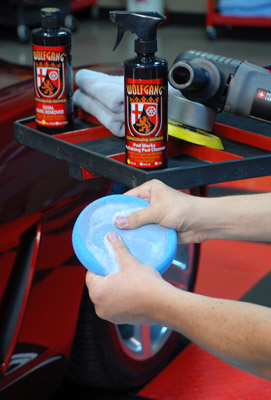 Thoroughly work Wolfgang Pad Werks Polishing Pad Cleaner into the pad and rinse it with water when finished cleaning
