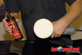 Apply an X of Wolfgang Paintwork Polish Enhancer across the white polishing pad.
