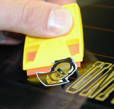 Use ScrapeRite Plastic Razor Blades to safely remove stickers from auto paint.
