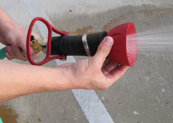 Turn the top of the High Flow Fire Hose Nozzle to adjust the flow.