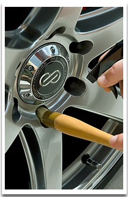 The Clean Wheel Lug Nut Wheel Brush cleans lug nuts and brake calipers with natural boar's hair bristles.