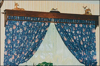 The Katie Cornice used to protect curtains & display collectibles.