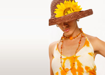 Woman with yellow sunflower and yellow bead necklace.
