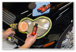 Apply Wolfgang Plastik Lens Cleaner with the orange pad.