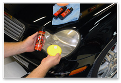 Apply Wolfgang Plastik Surface Sealant with the yellow foam applicator.
