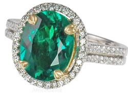 Emerald mounted in Platinum Diamond Ring