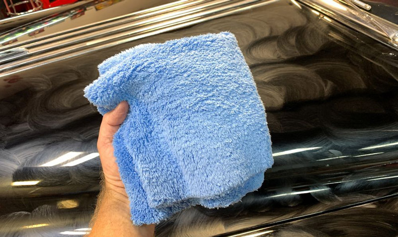 Towel in hand about to buff off dried on wax.