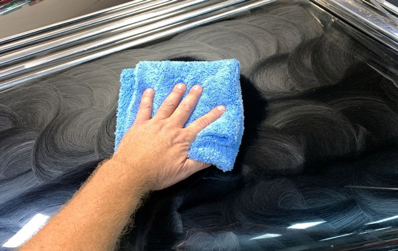 Speed Master Towel buffing off dried on wax from car.