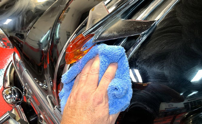 New Shot of Speed Master microfiber towel buffing away dried on wax.