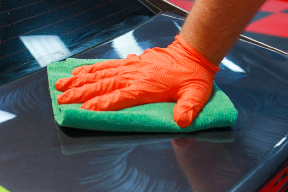 Buff any remaining DP Compound off the surface using a clean microfiber towel once you are done working the product.
