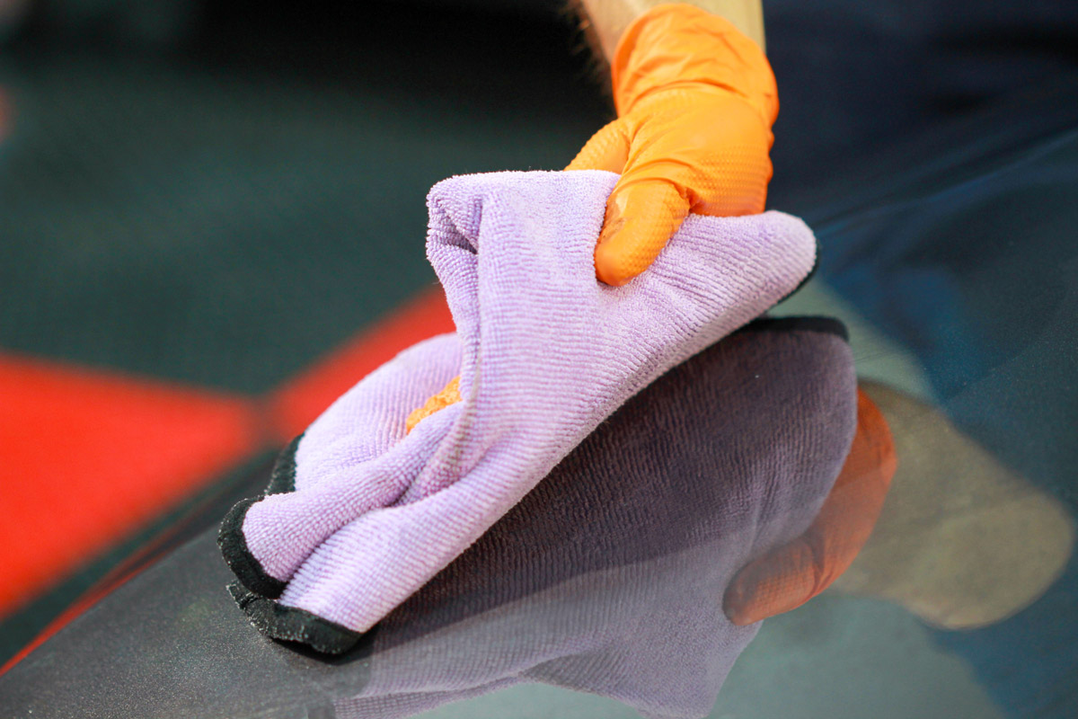 Using a clean microfiber towel, spread DP Poli-Coat Spray Sealant evenly across the panel.