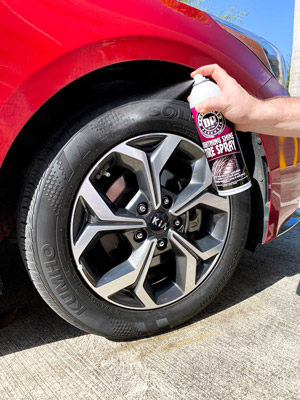 Image shows DP Lightning Shine Tire Spray being sprayed on the tire's sidewall