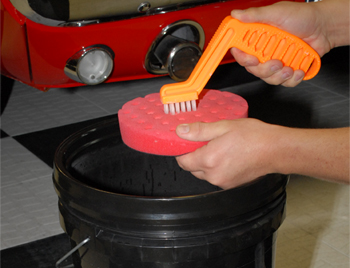 Use a foam pad conditioning brush to scrub pads.