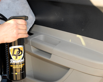 Apply Detailer's Pro Series Interior Surface Protectant with a soft microfiber towel.
