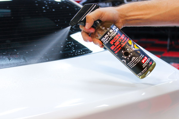 Spray P&S Iron Buster liberally on your car's paint, ensuring you cover the entirety of the surface!