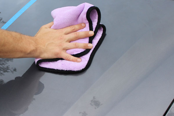 Using a clean microfiber towel, spread DP Need for Bead evenly across the surface.