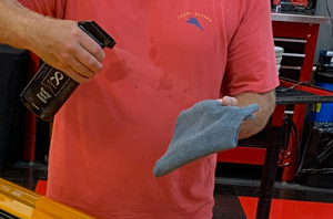 Spray Pinnacle Black Label Synergy Spray Sealant directly on the paint and on your application towel.