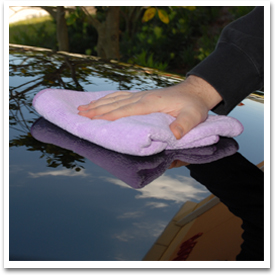 Use a soft Cobra Microfiber Towel to buff off Purple Haze Wax.