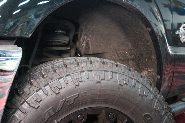 Pinnacle Citrus Splash All Purpose Cleaner can be used to clean this dirty wheel well.