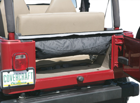 The Qwik Cover folds into a built-in storage bag that can be attached to the Jeep's rear window anchor bar.