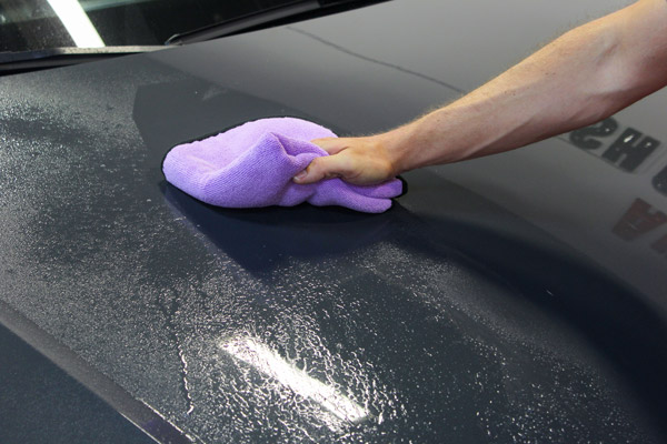 Using a clean and dry microfiber towel, wipe Wolfgang Ceramic Detail Spray across the surface. Then use a second clean microfiber towel to buff off any excess product.