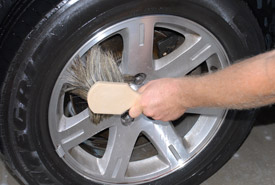 Use a Boar's Hair Wash Brush on the wheel face.