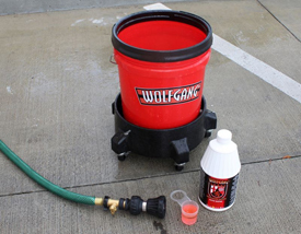 Wolfgang Auto Bathe shown with 5-Gallon Wash Bucket with 5 Wheel Car Wash Dolly and Firehose Nozzle.