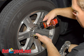 Apply a small amount of Wolfgang Black Diamond Tire Gel to the applicator.